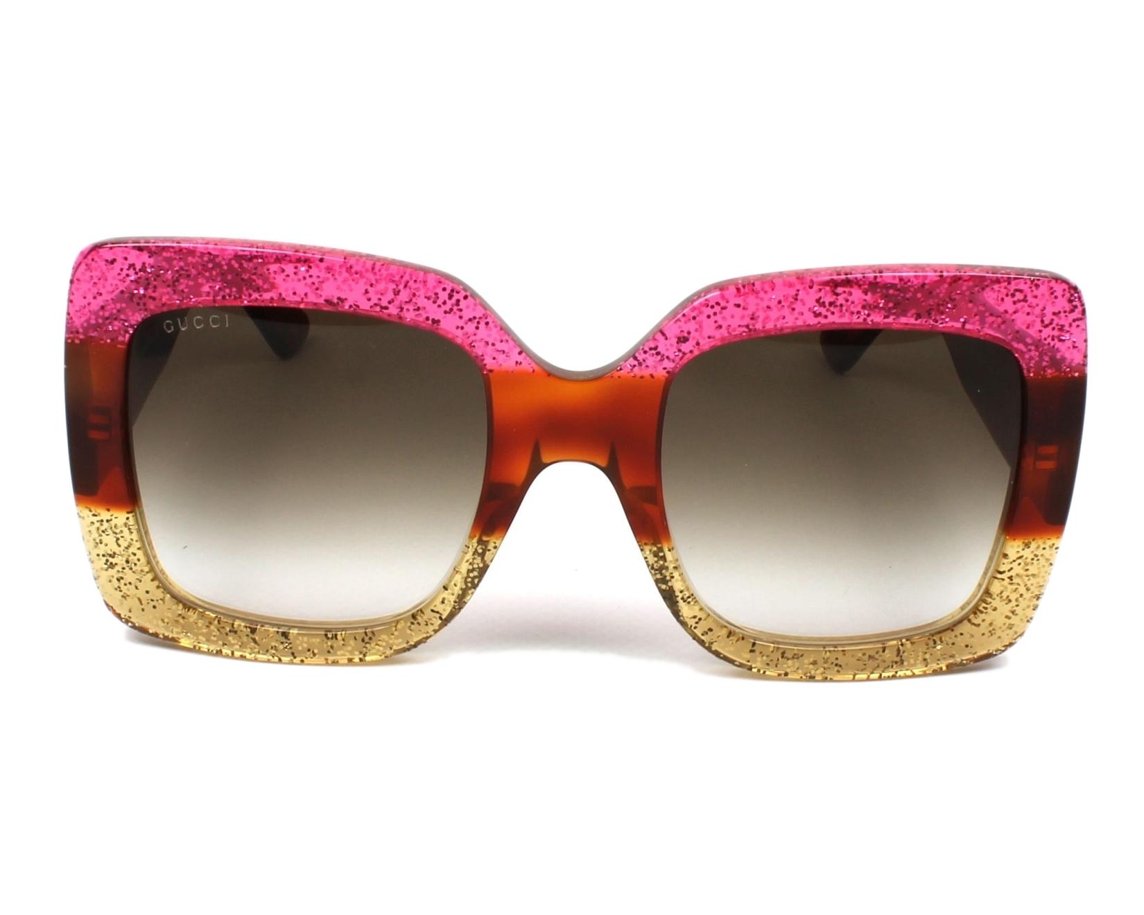 cc97946fec9 Sunglasses Gucci GG-0083-S 002 55-24 Fuchsia Brown front view